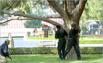 National Security Guard commandos take up positions outside Parliament House, following the terrorist attack