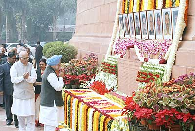 A file photograph of BJP leader L K Advani and Prime Minister Manmohan Singh paying homage to those killed in the Parliament attack