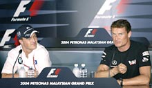 McLaren driver David Coulthard (R) from Scotland and Willams driver Ralf Schumacher from Germany answer questions at a news conference at the Sepang Circuit